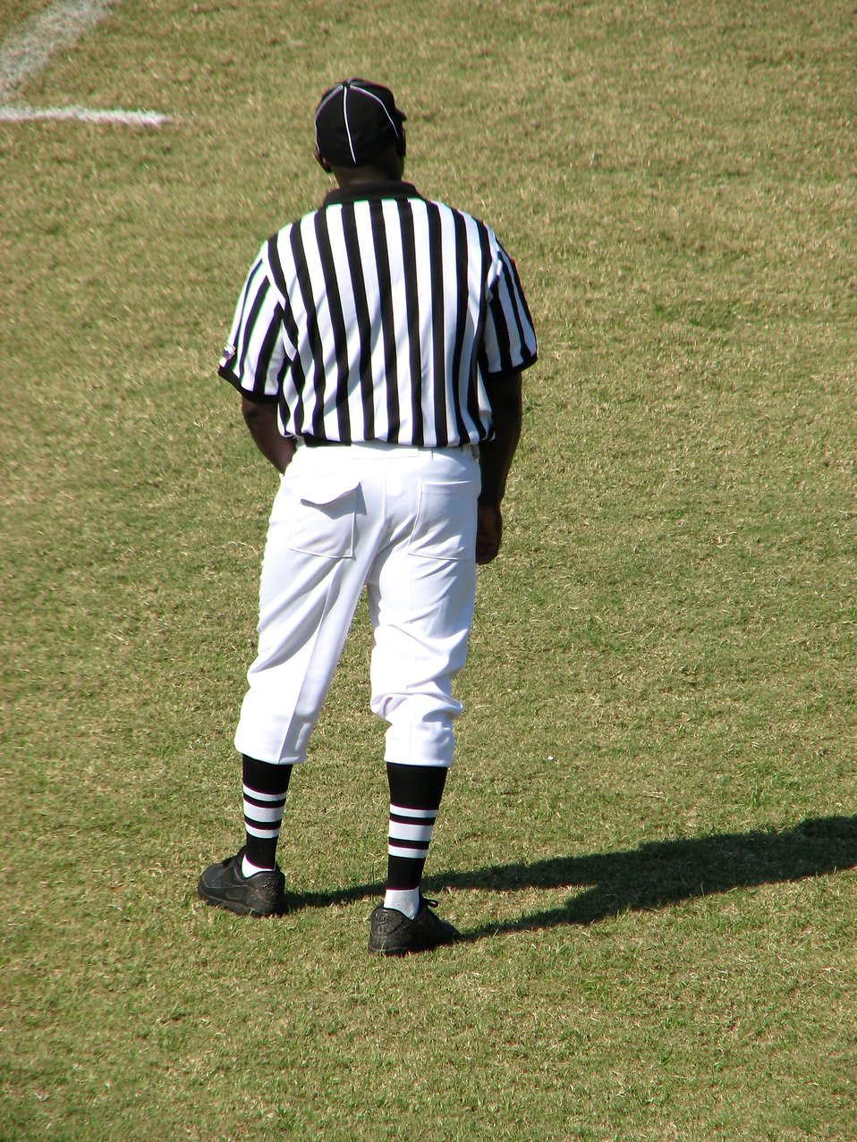 A football referee on a field : Free Stock Photo