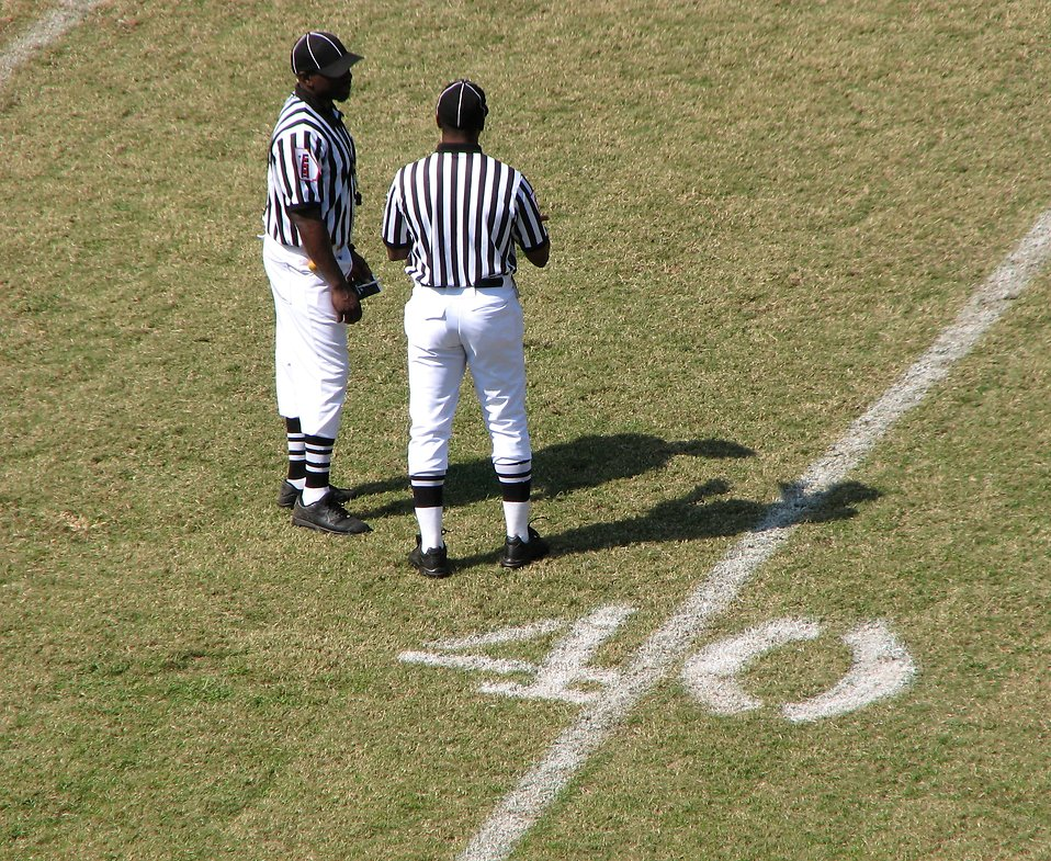 Football referees on a field : Free Stock Photo