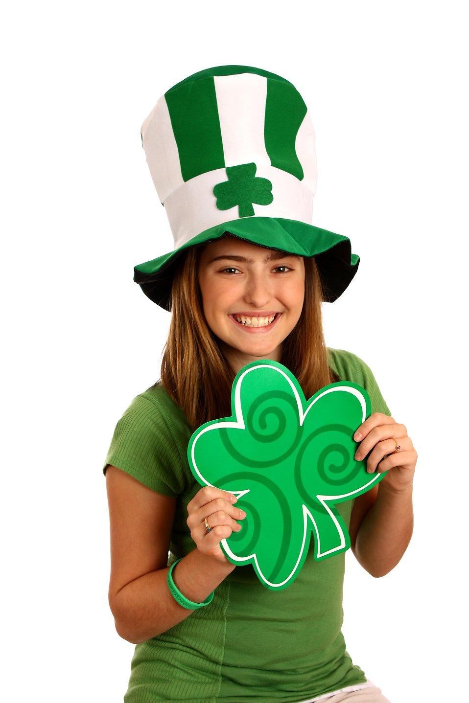 A cute young girl dressed up for Saint Patrick's Day holding a large clover : Free Stock Photo