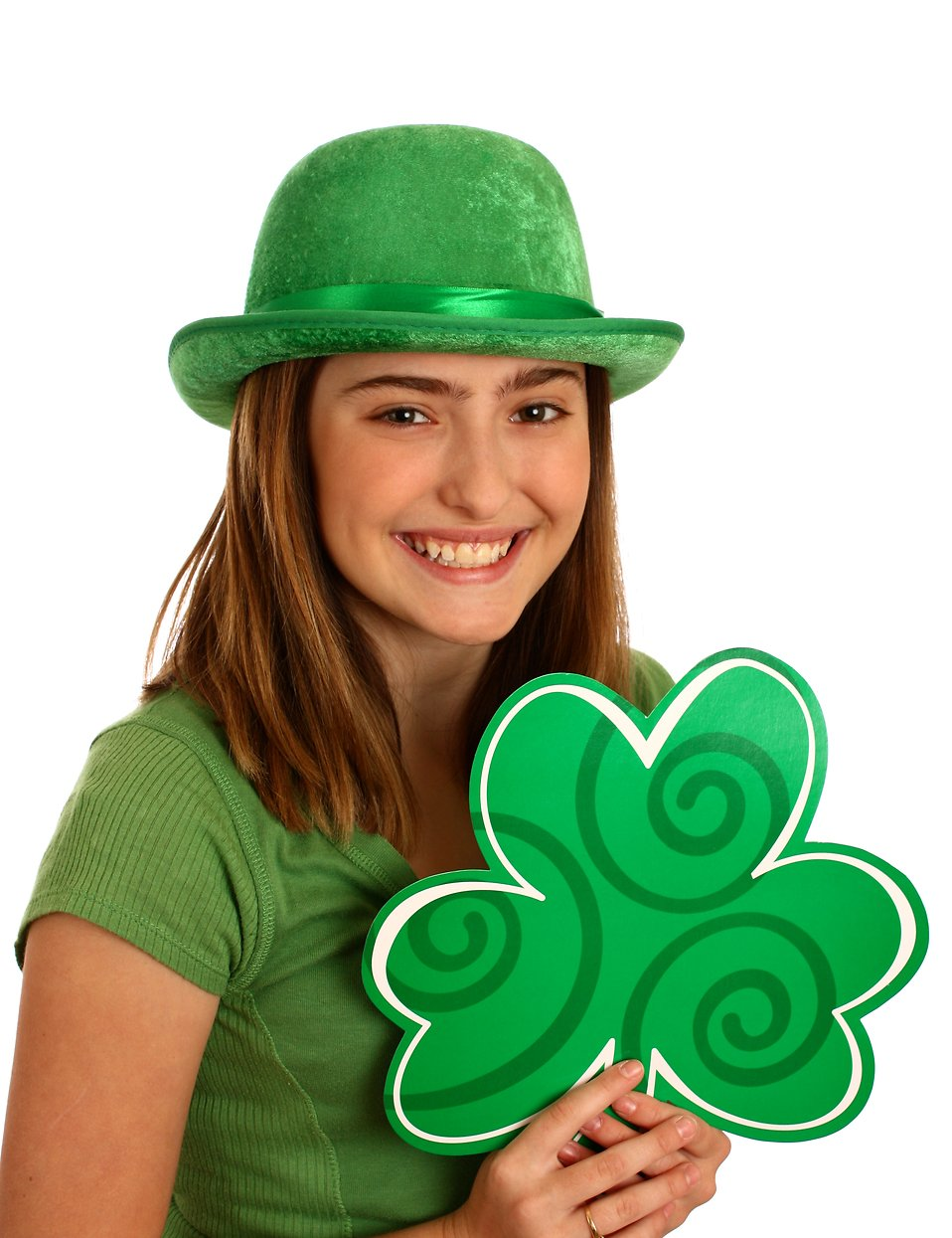 A cute young girl dressed up for Saint Patrick's Day holding a large shamrock : Free Stock Photo