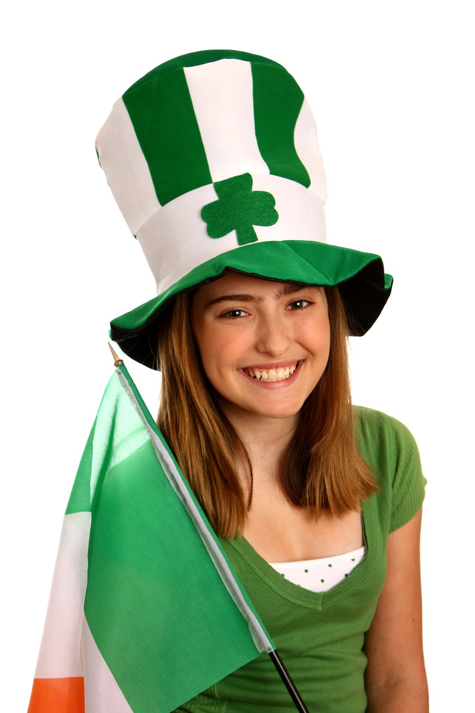 A cute young girl dressed up for Saint Patrick's Day holding an Irish flag : Free Stock Photo