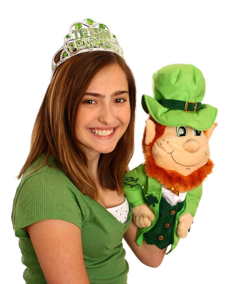 A cute young girl dressed up for Saint Patrick's Day holding a leprechaun puppet : Free Stock Photo