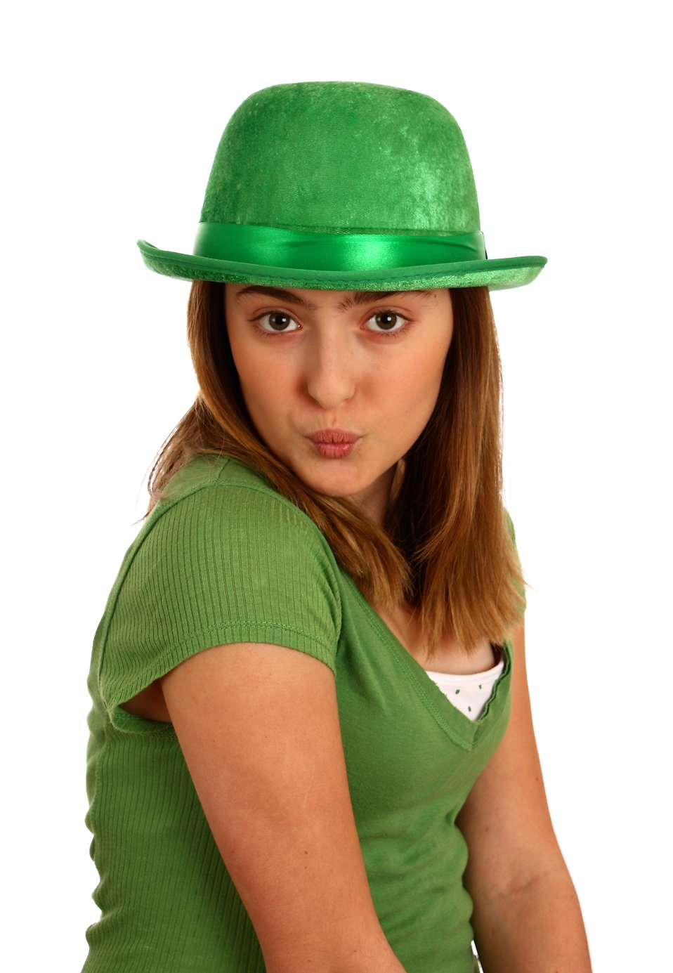 A cute young girl dressed up for Saint Patrick's Day blowing a kiss : Free Stock Photo