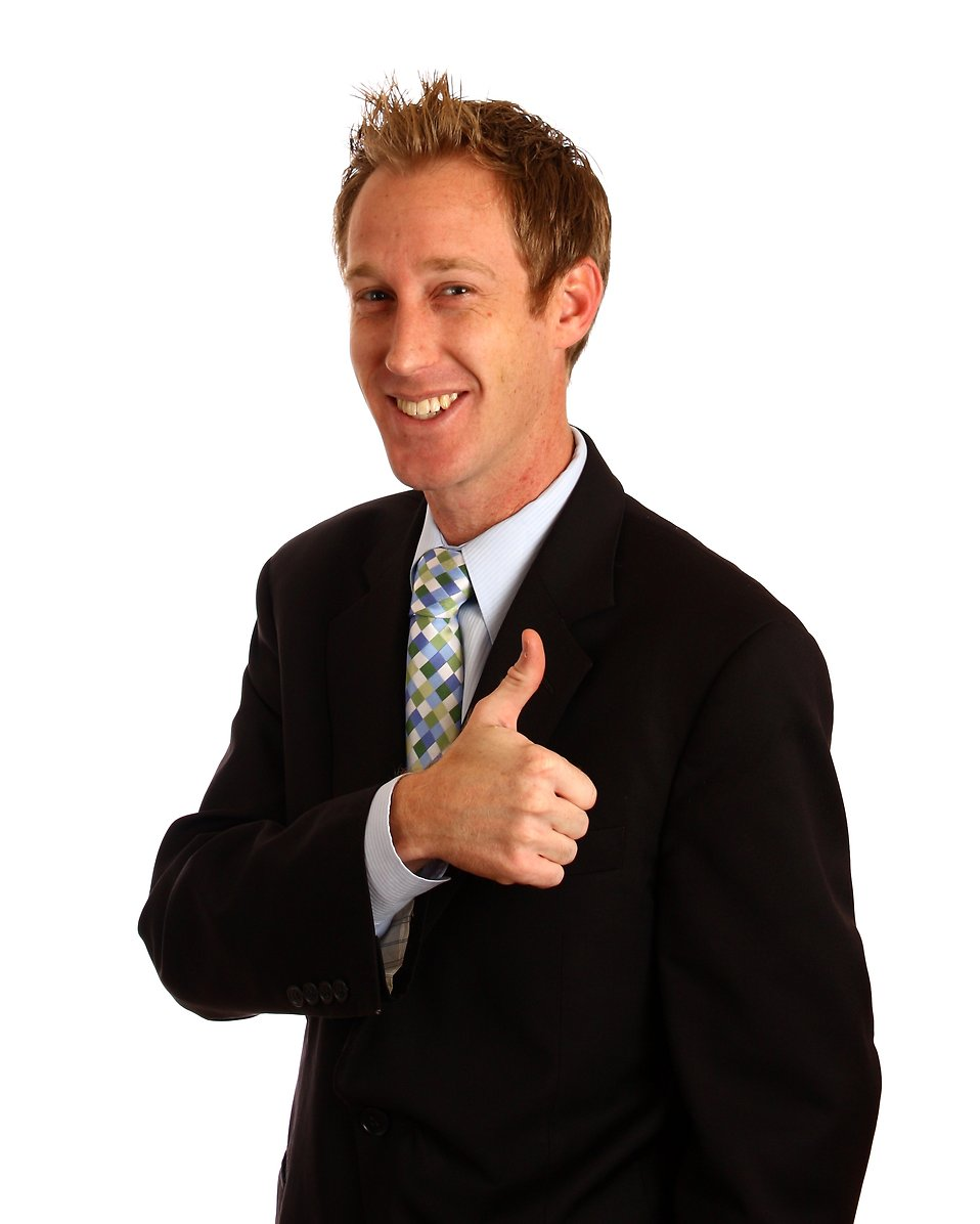 A young businessman giving a thumbs up signal with his hands : Free Stock Photo