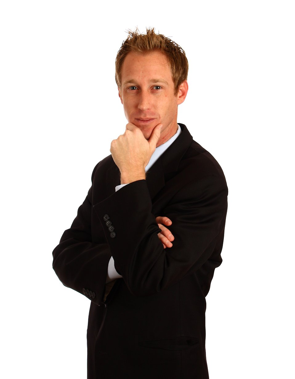 A young businessman in a suit isolated on a white background.