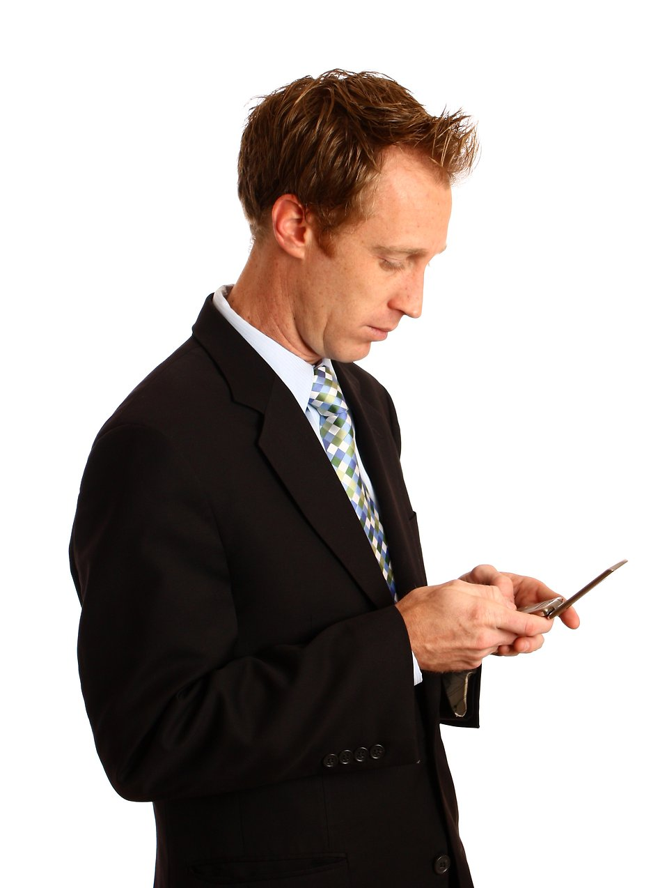 A young businessman texting on a cell phone : Free Stock Photo