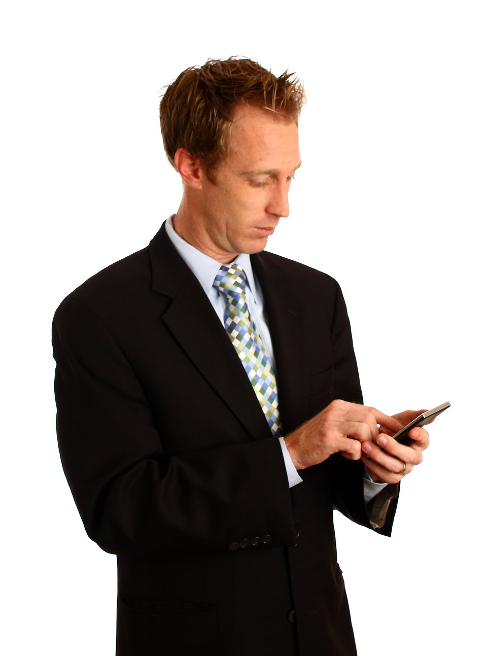 A young businessman in a suit using a calculator : Free Stock Photo