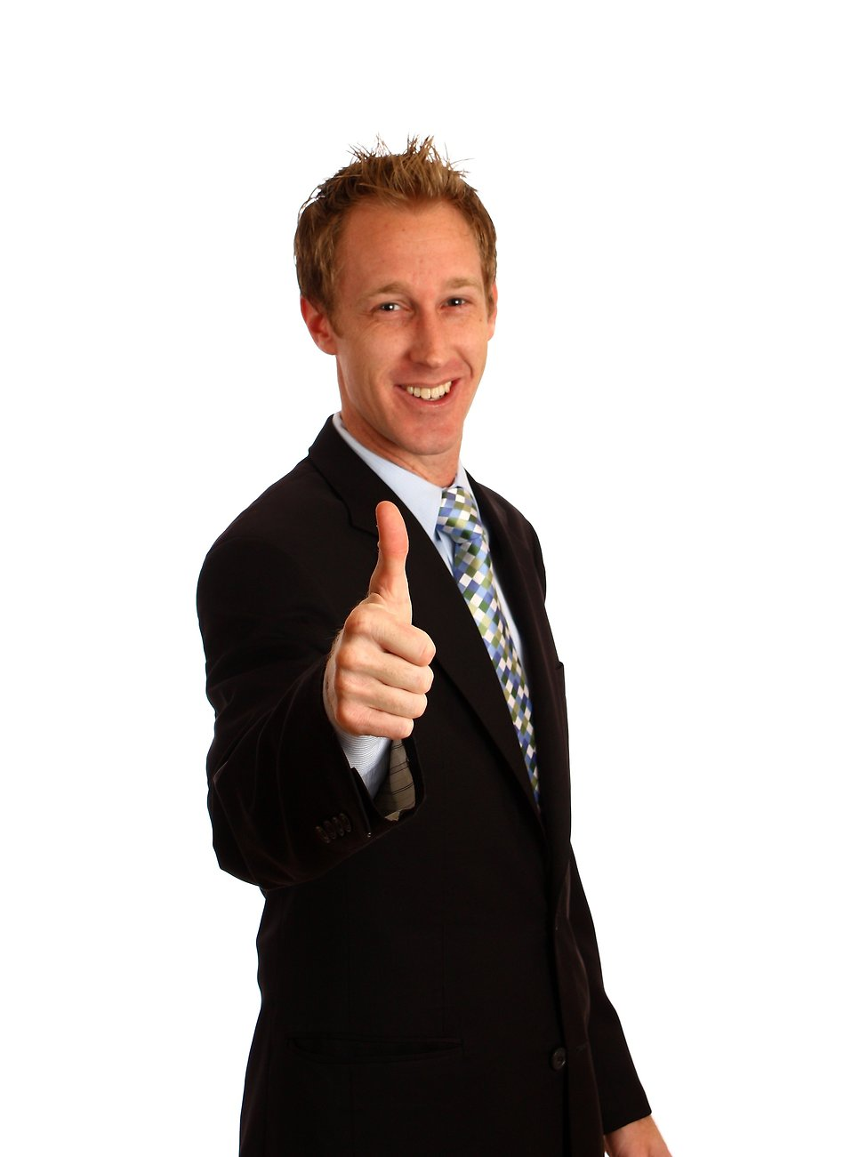 A young businessman giving a thumbs up signal.