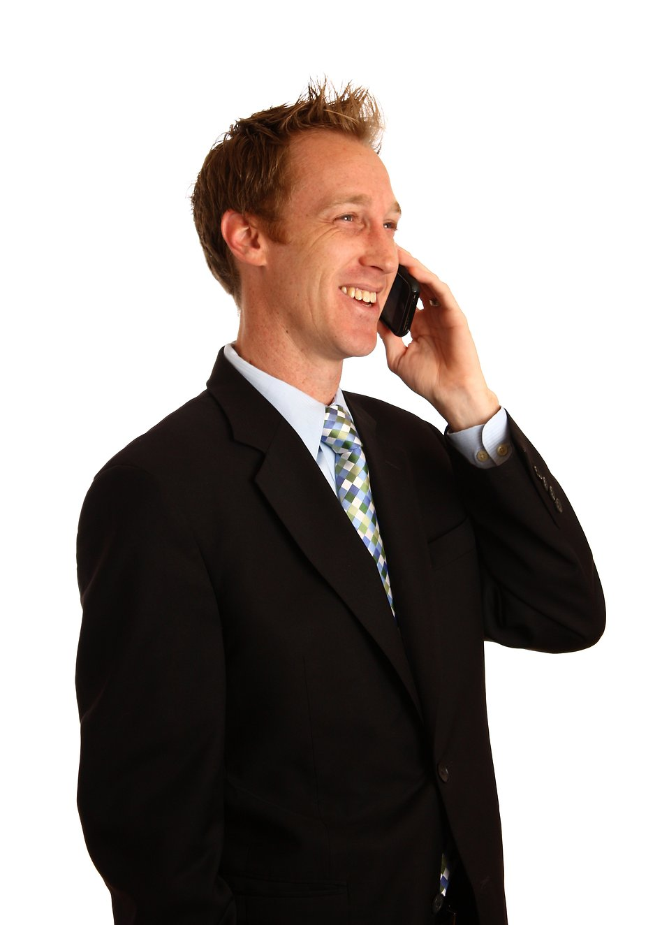 A young businessman talking on a cell phone : Free Stock Photo