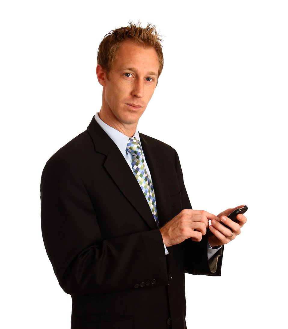A young businessman using a smart phone : Free Stock Photo