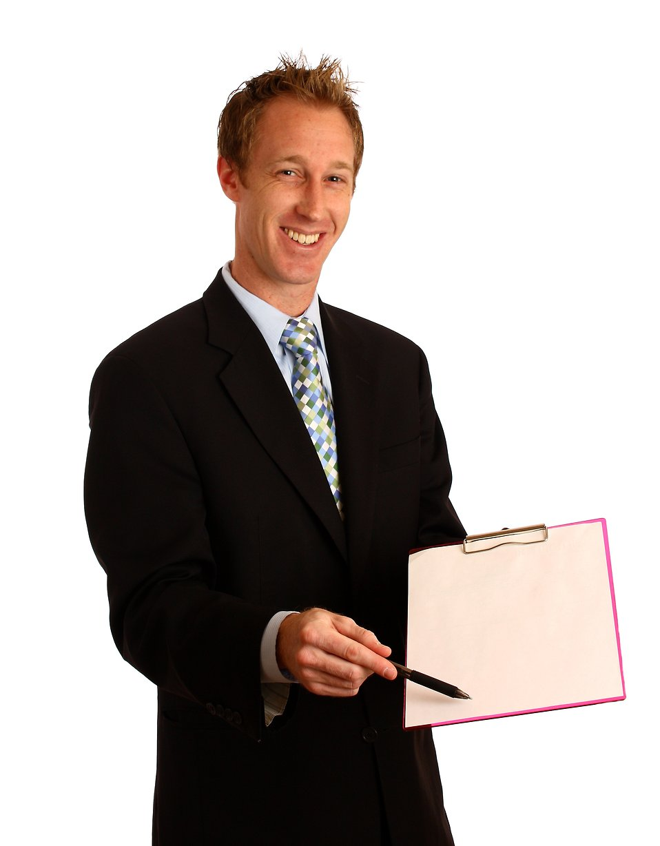 A young businessman holding a clipboard and pen : Free Stock Photo