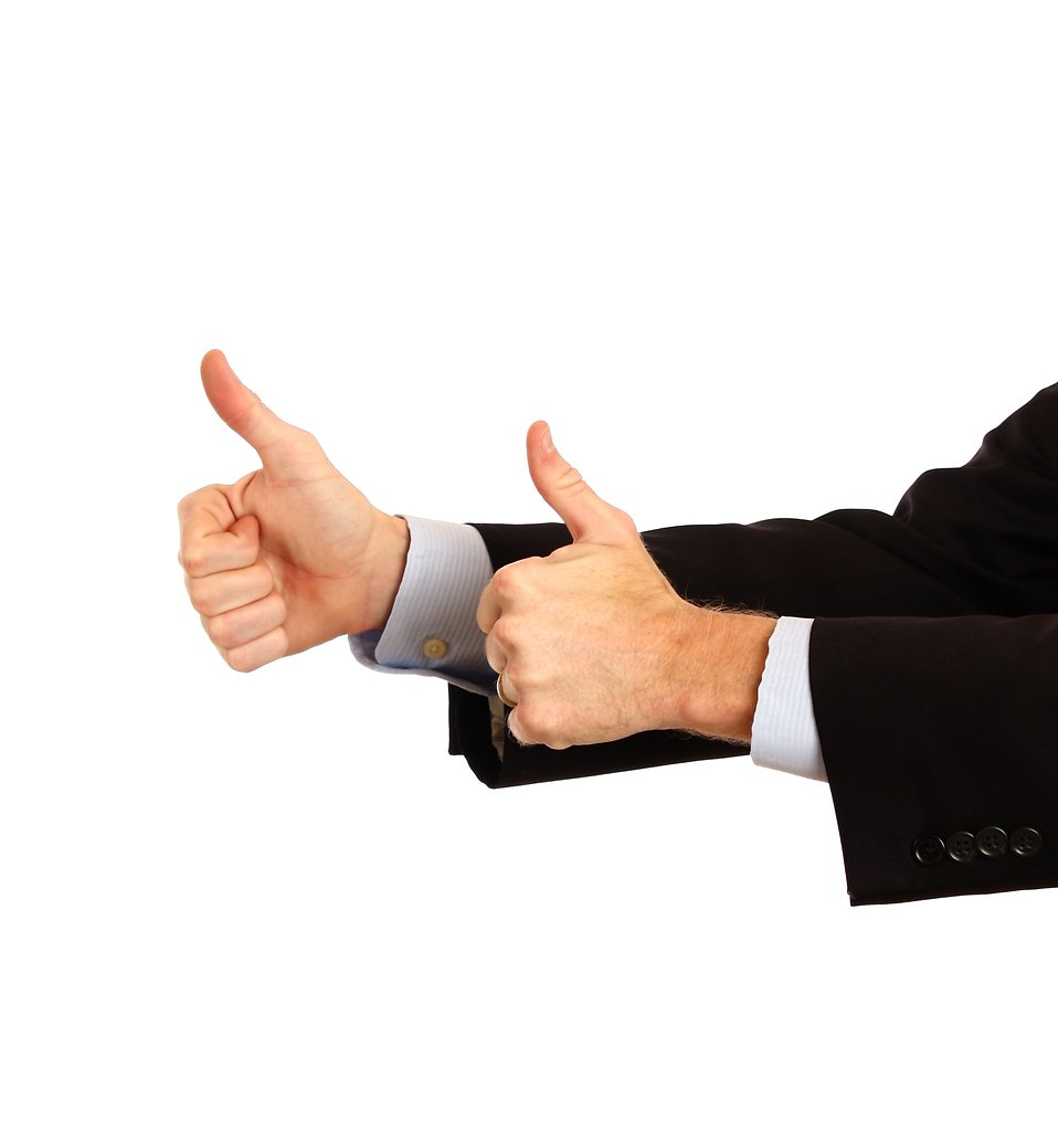 A young businessman making a thumbs up gesture : Free Stock Photo