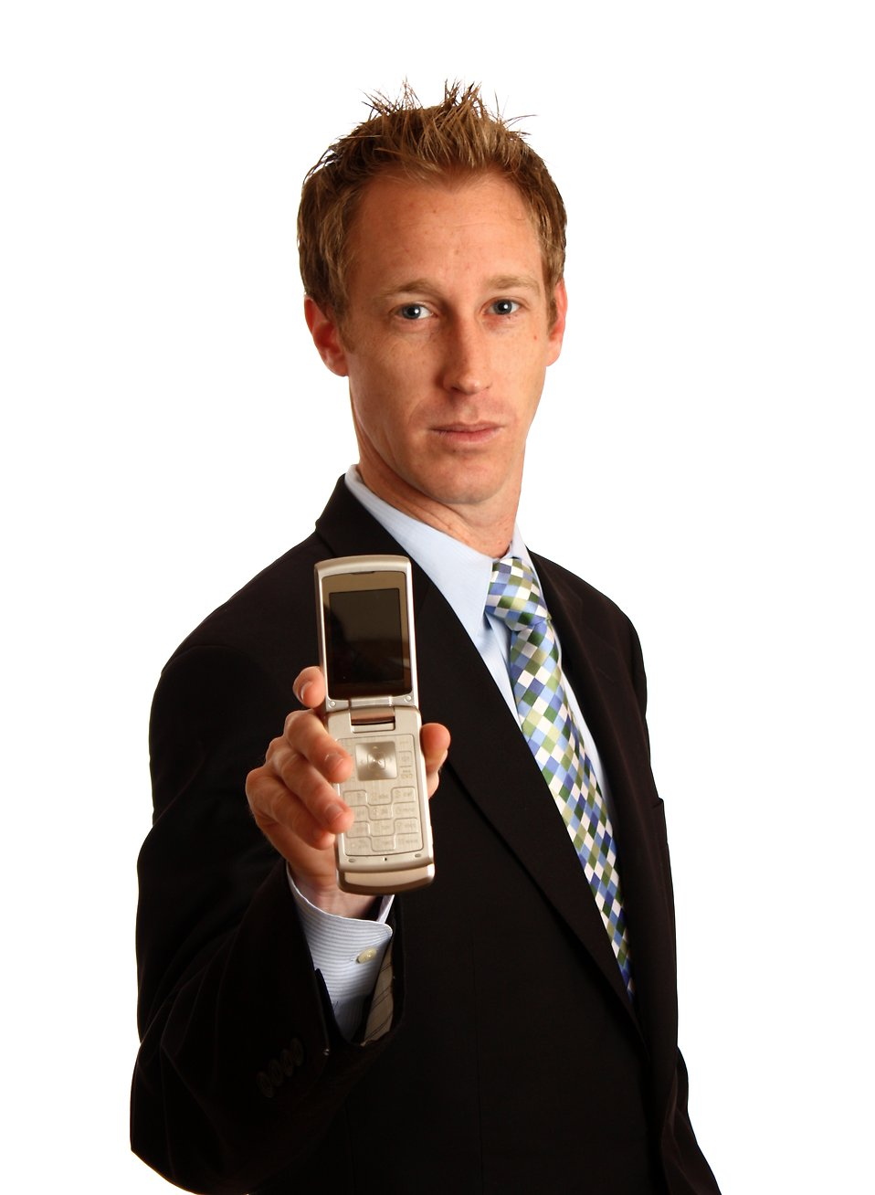 A young businessman holding a cell phone : Free Stock Photo