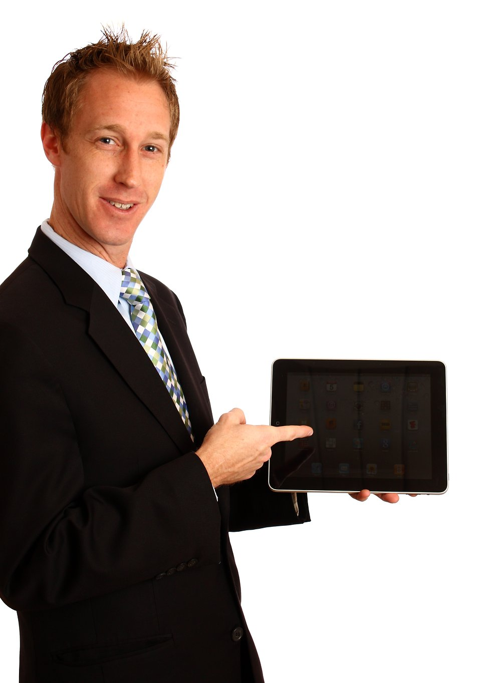 A young businessman holding a tablet computer.