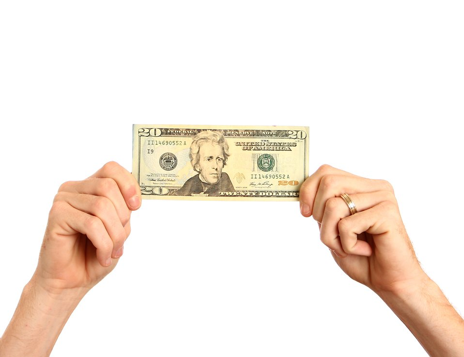 Hands holding up a twenty dollar bill : Free Stock Photo