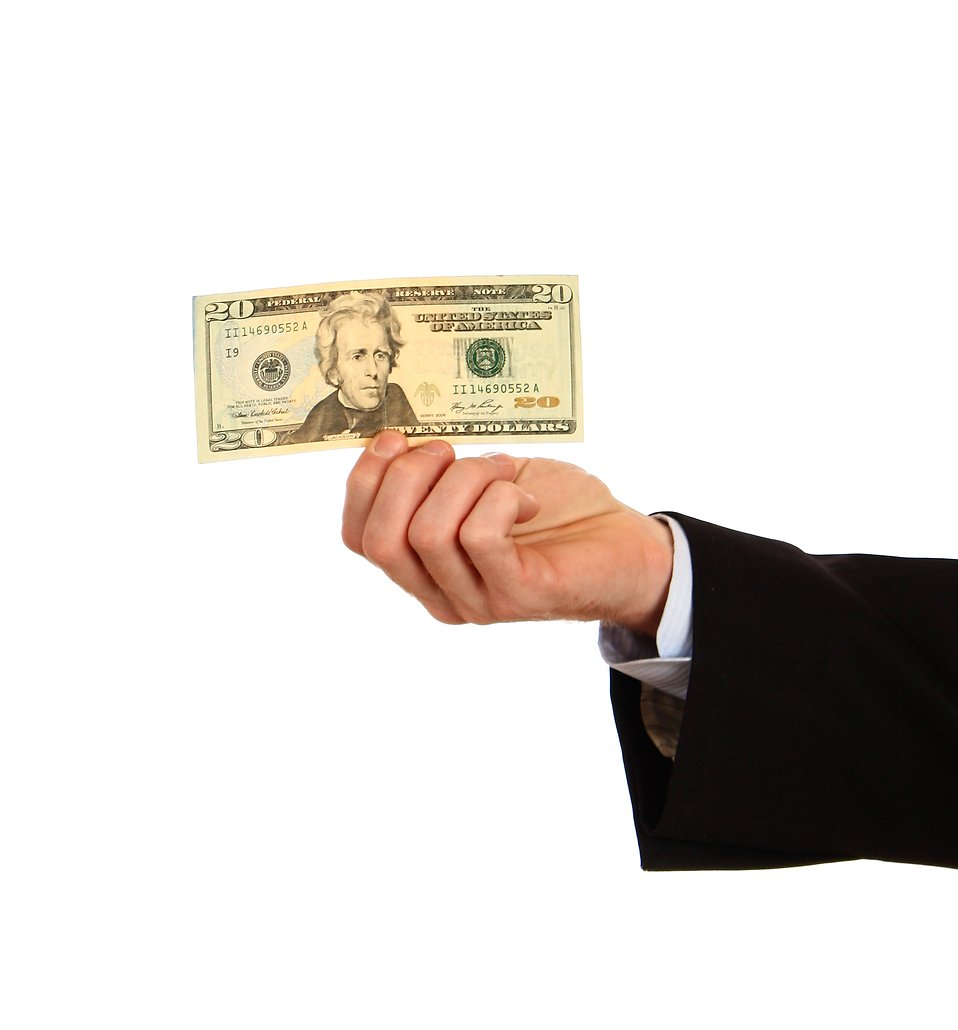 A hand holding a twenty dollar bill : Free Stock Photo