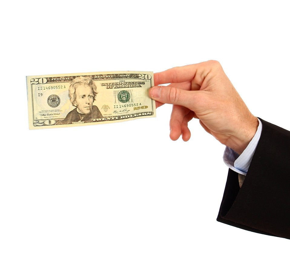 A hand holding a twenty dollar bill : Free Stock Photo