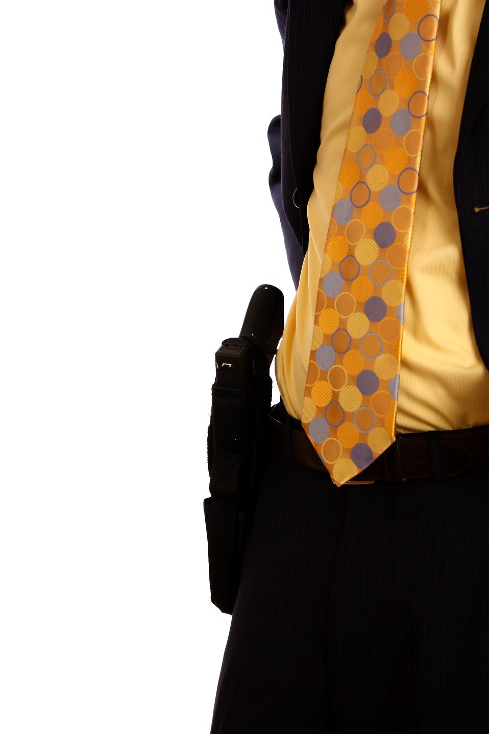 Close-up of a pistol in a holster on the belt of a businessman : Free Stock Photo