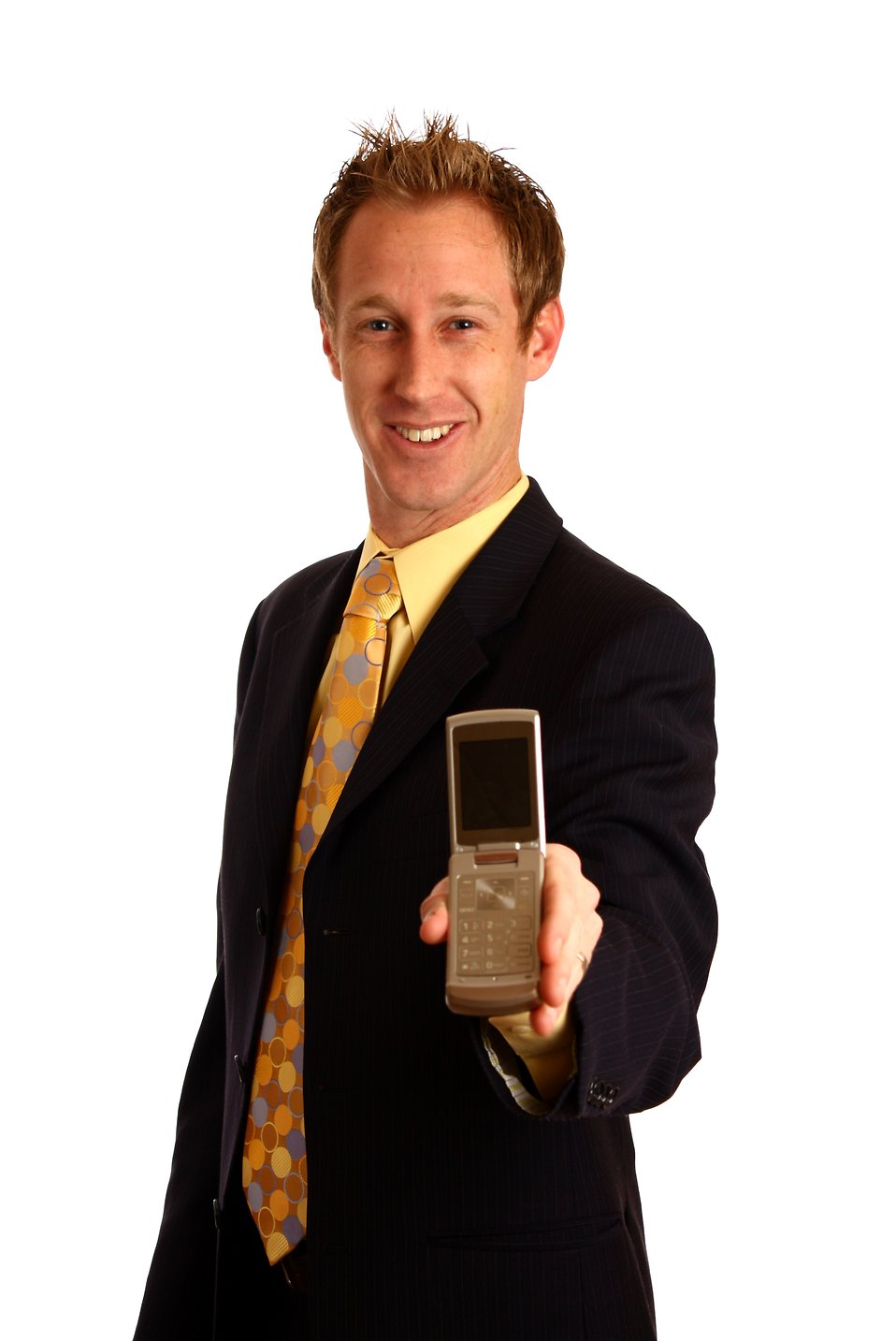 A young businessman in a suit holding a cell phone : Free Stock Photo