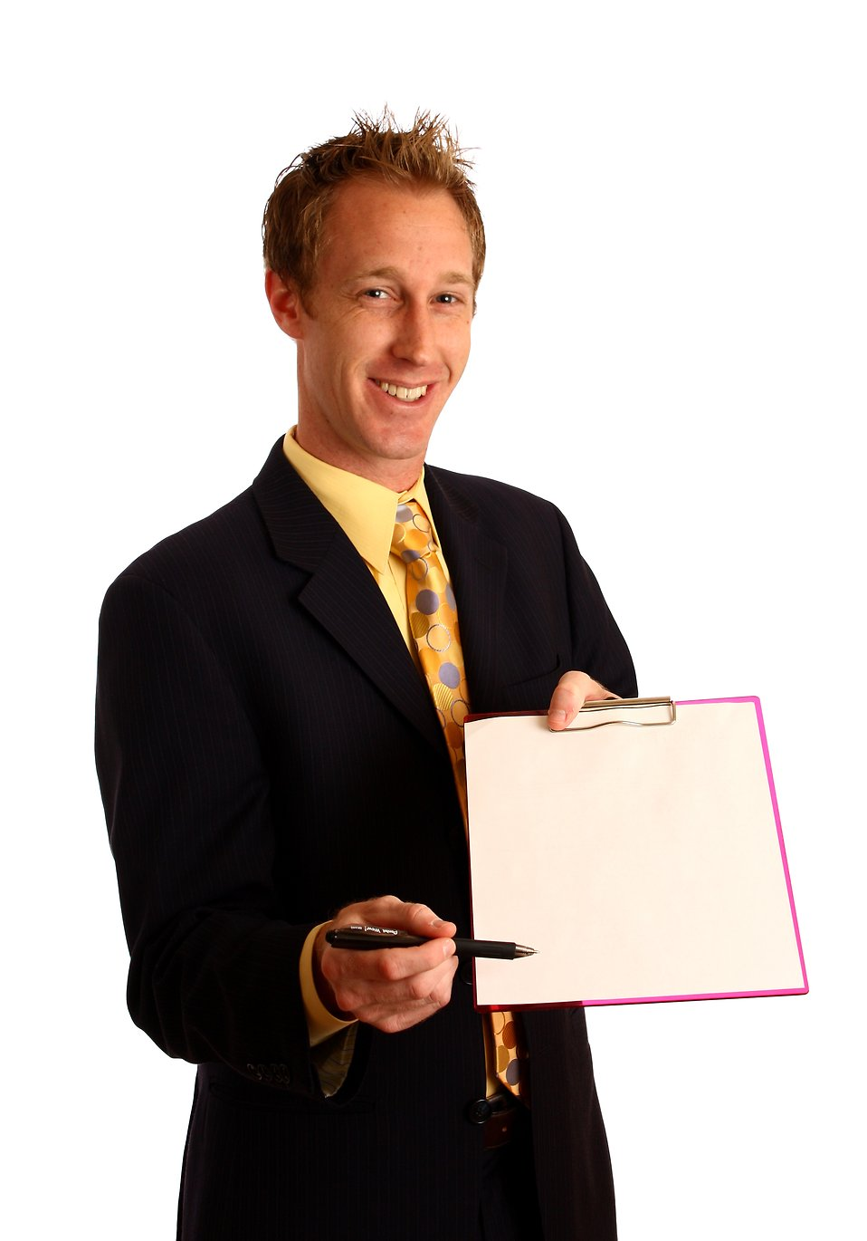 A young businessman in a suit holding a clipboard and pen : Free Stock Photo
