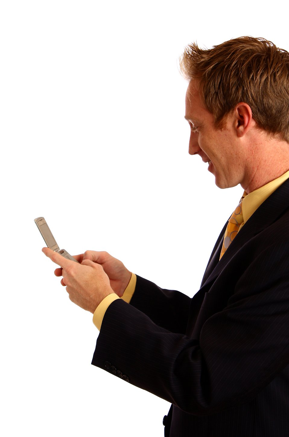 A young businessman in a suit texting on a cell phone : Free Stock Photo