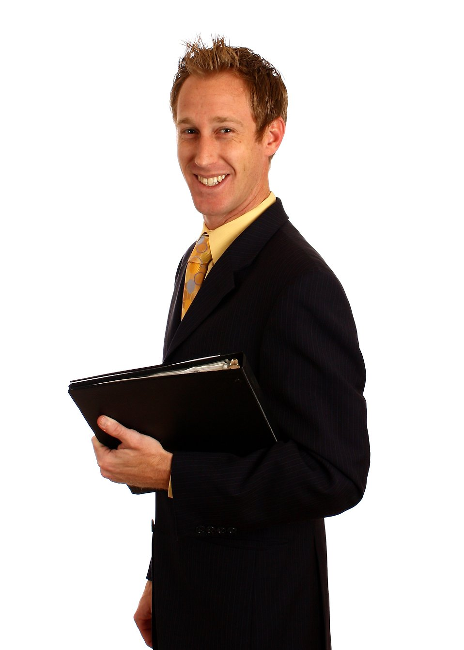 A young businessman in a suit holding a binder : Free Stock Photo