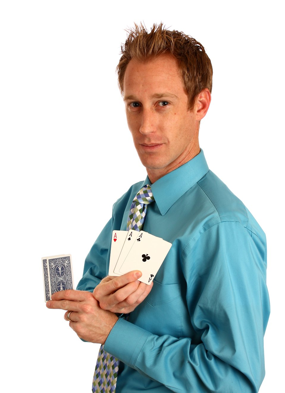 A young businessman holding a hand of playing cards : Free Stock Photo