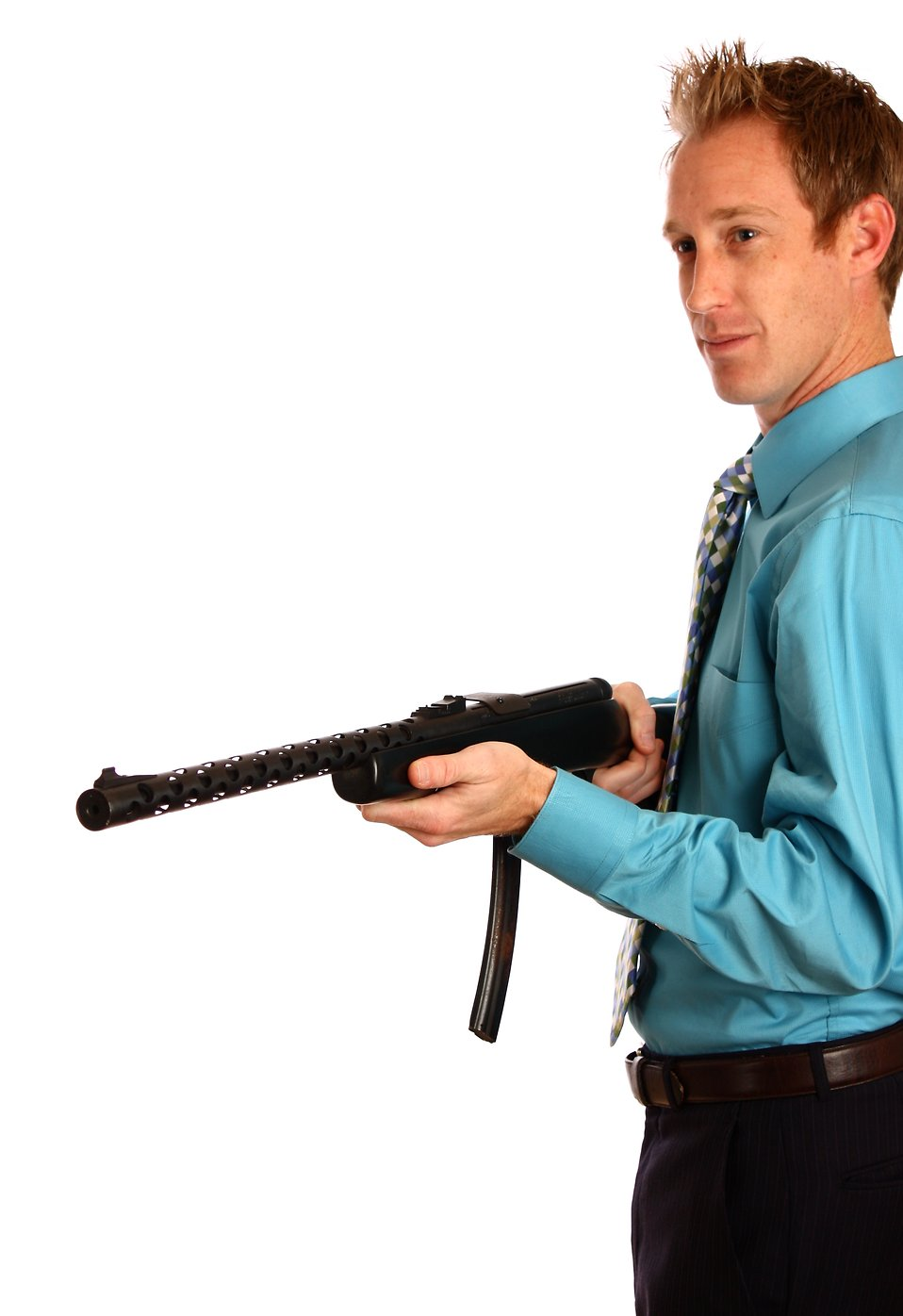 A young businessman holding a rifle.