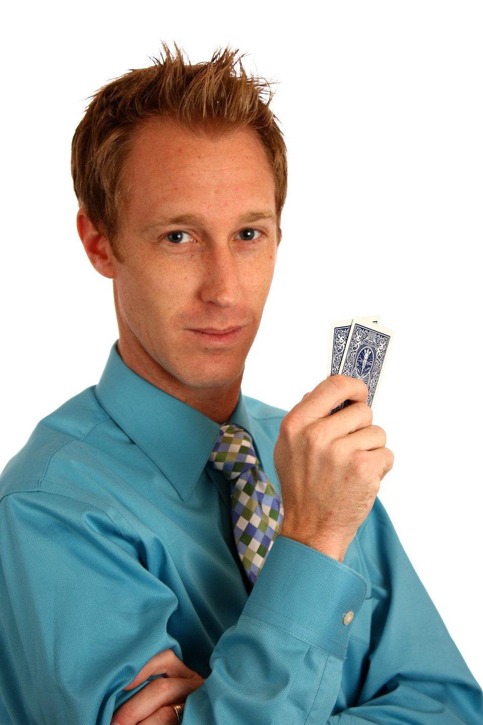 A young businessman holding a pair of playing cards : Free Stock Photo