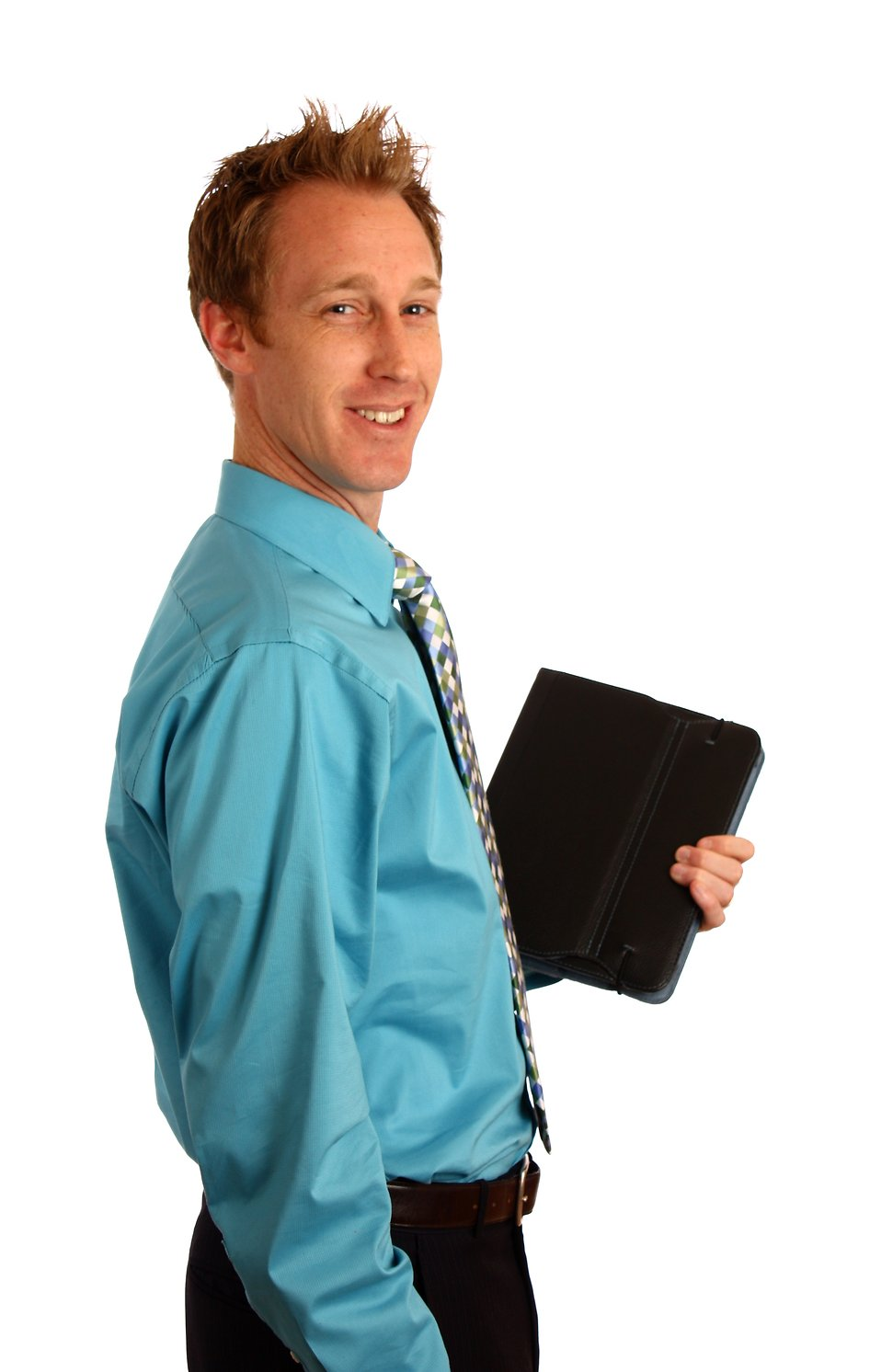 A young businessman holding a binder : Free Stock Photo