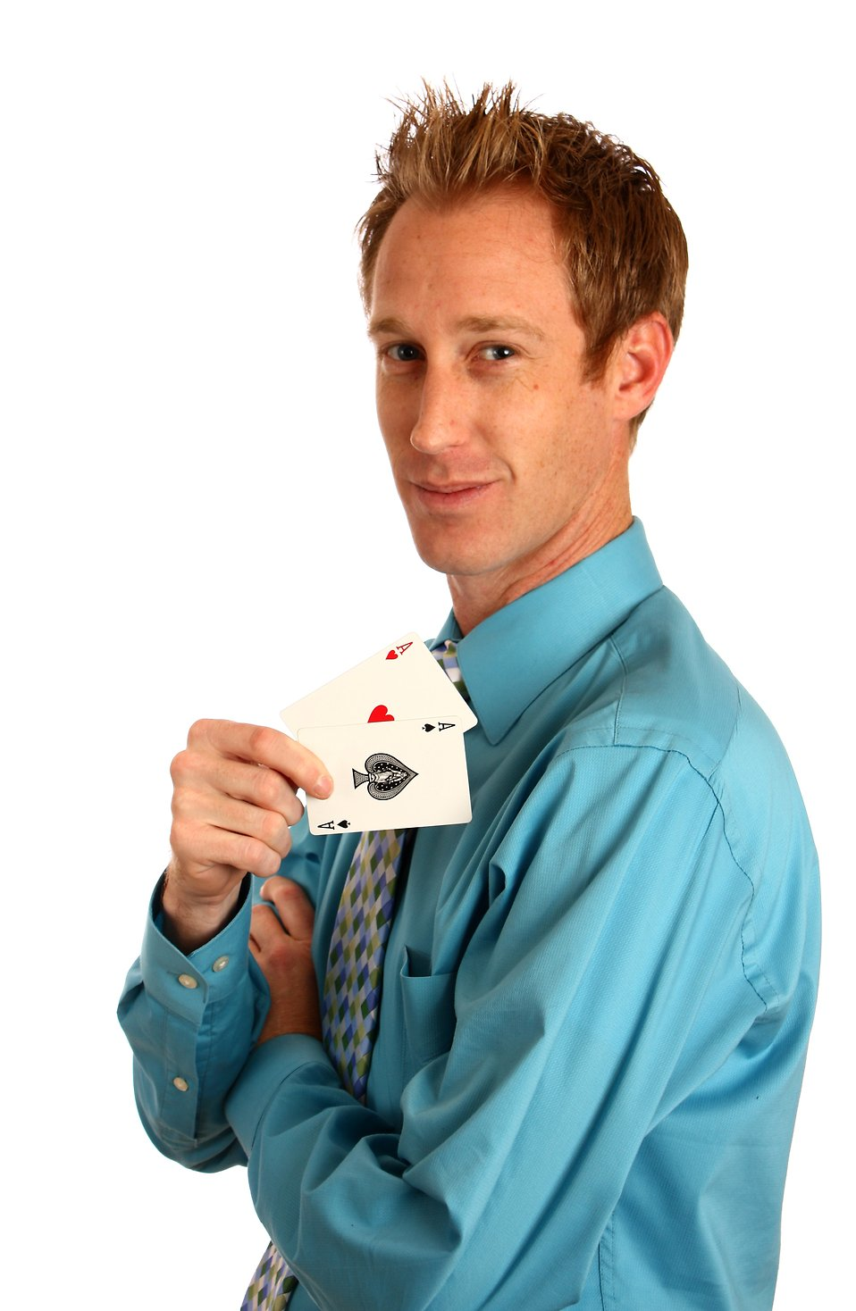 A young businessman holding a pair of aces : Free Stock Photo