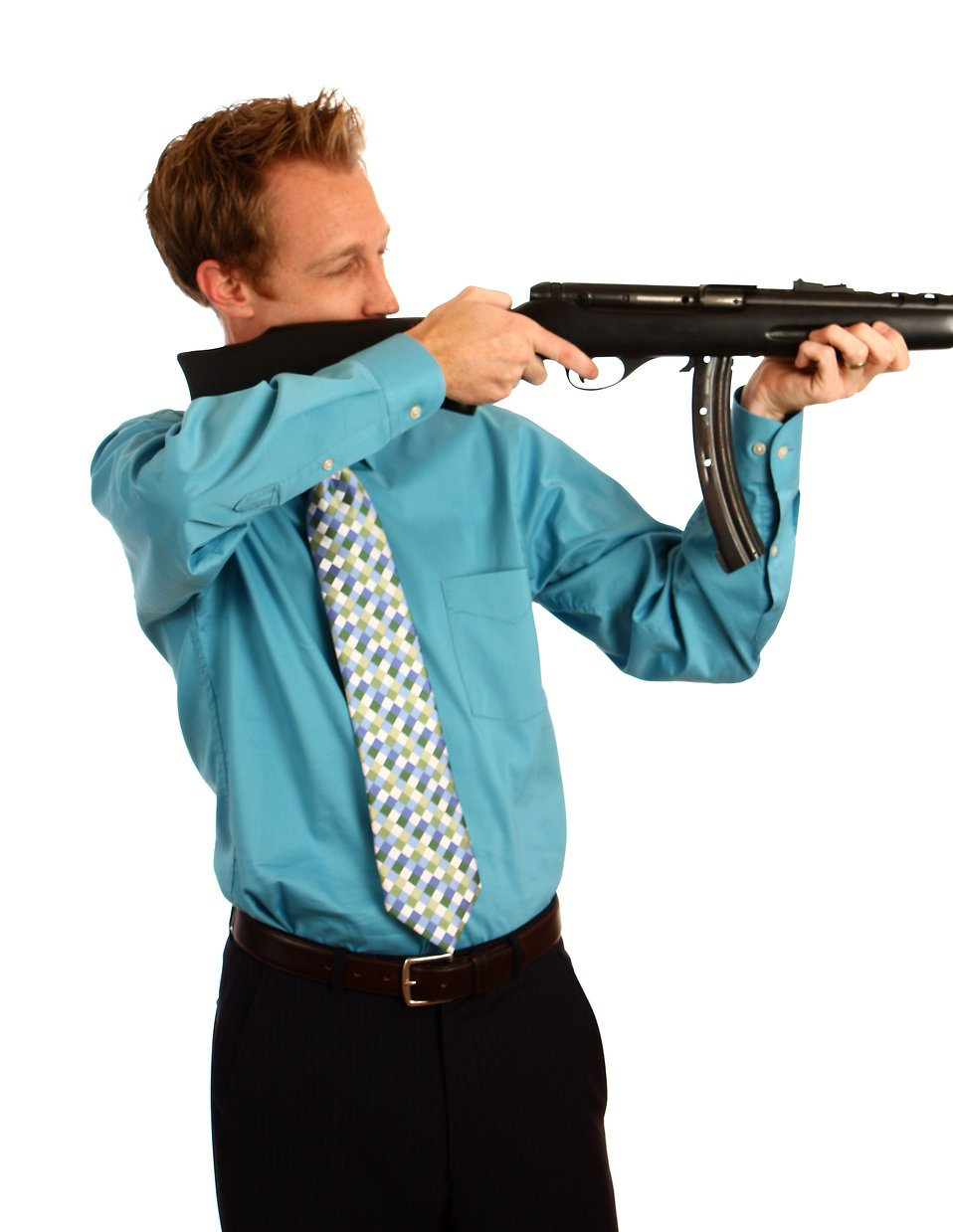A young businessman holding a rifle : Free Stock Photo