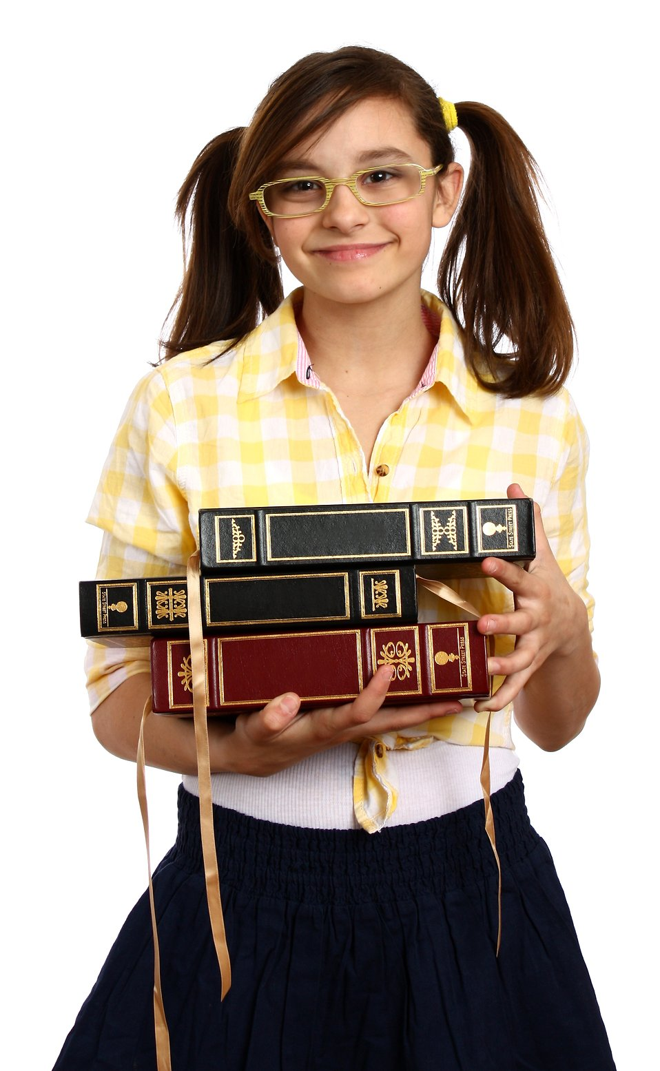 A smart girl with glasses holding a stack of books : Free Stock Photo