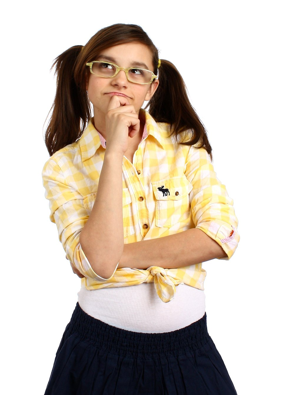 A smart girl with glasses posing with a thoughtful expression : Free Stock Photo
