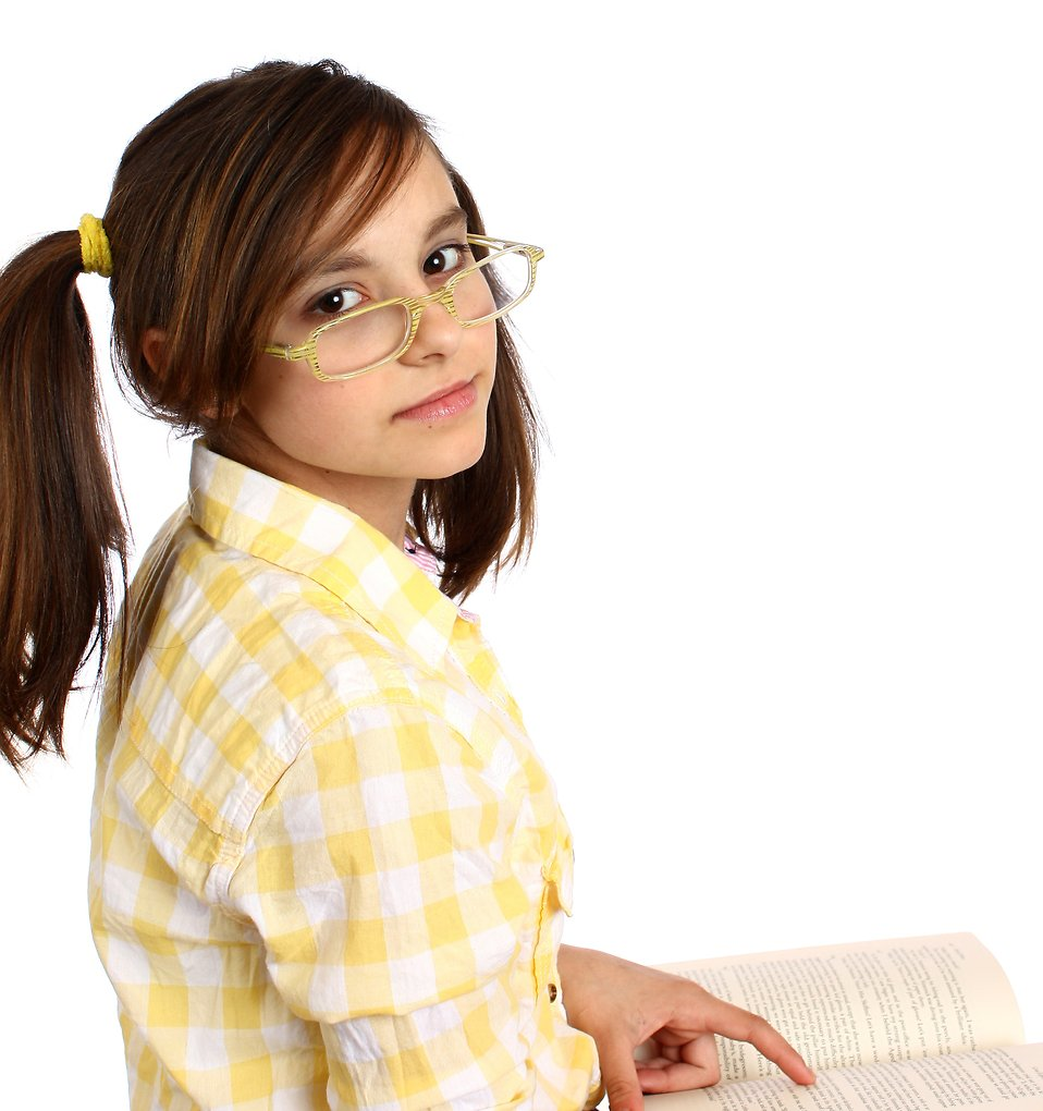 A smart girl with glasses reading a book : Free Stock Photo