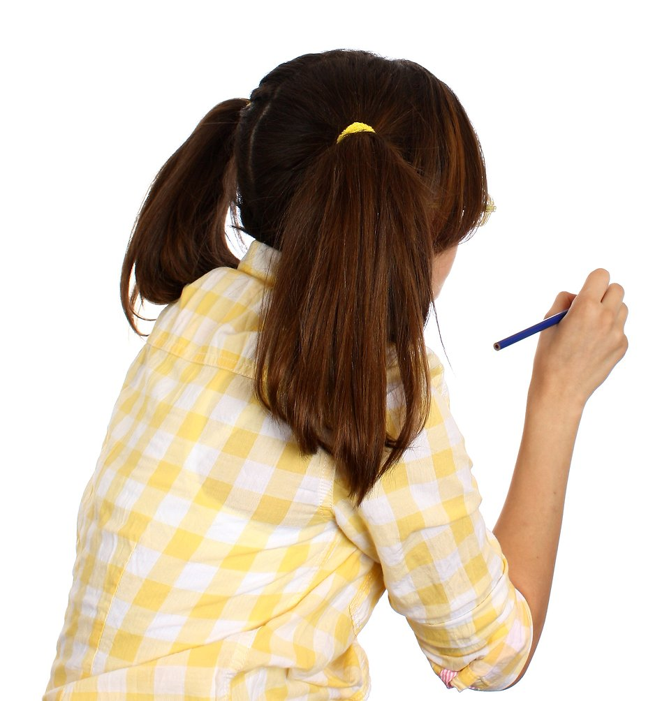 A smart girl with glasses writing with a pencil : Free Stock Photo