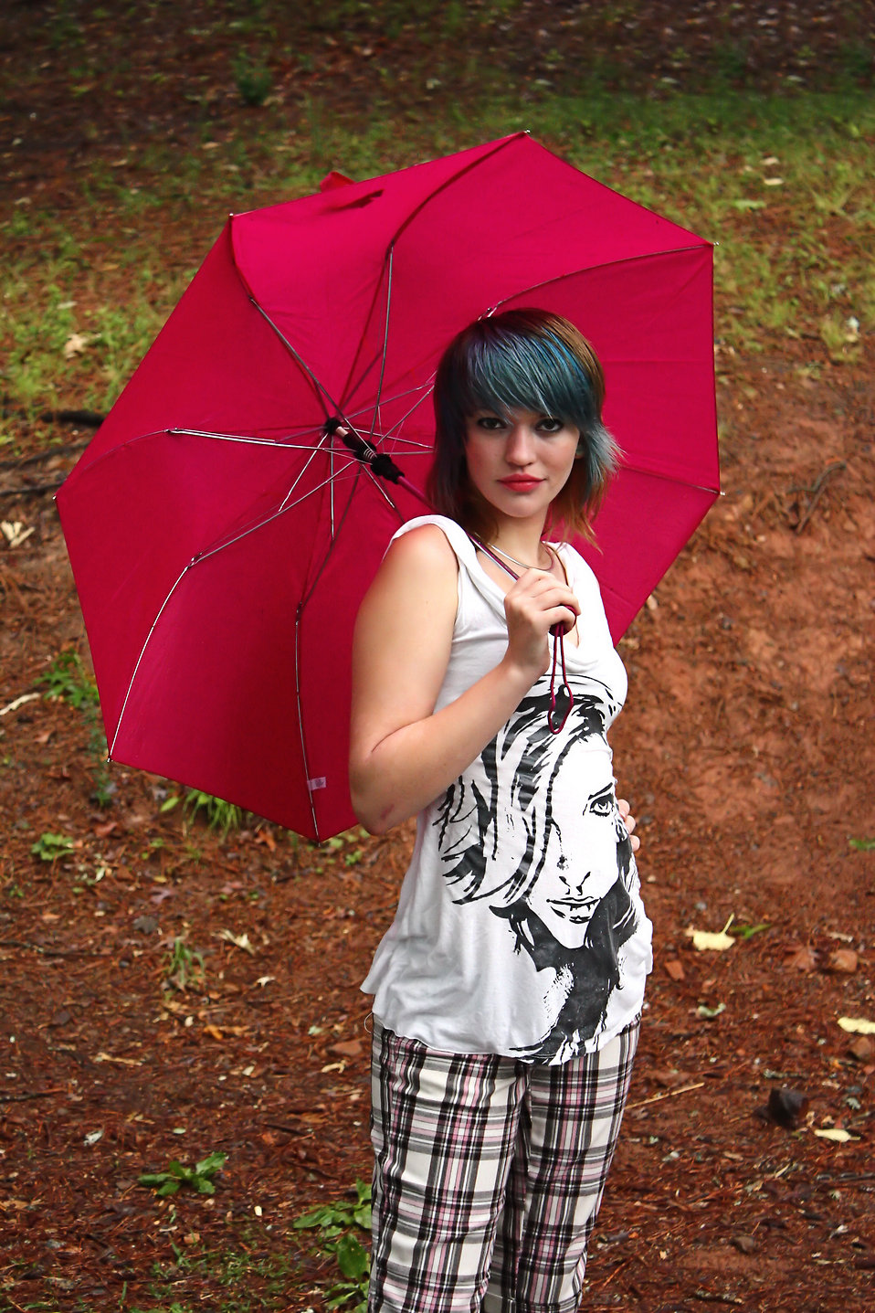 A beautiful young woman posing with an umbrella : Free Stock Photo