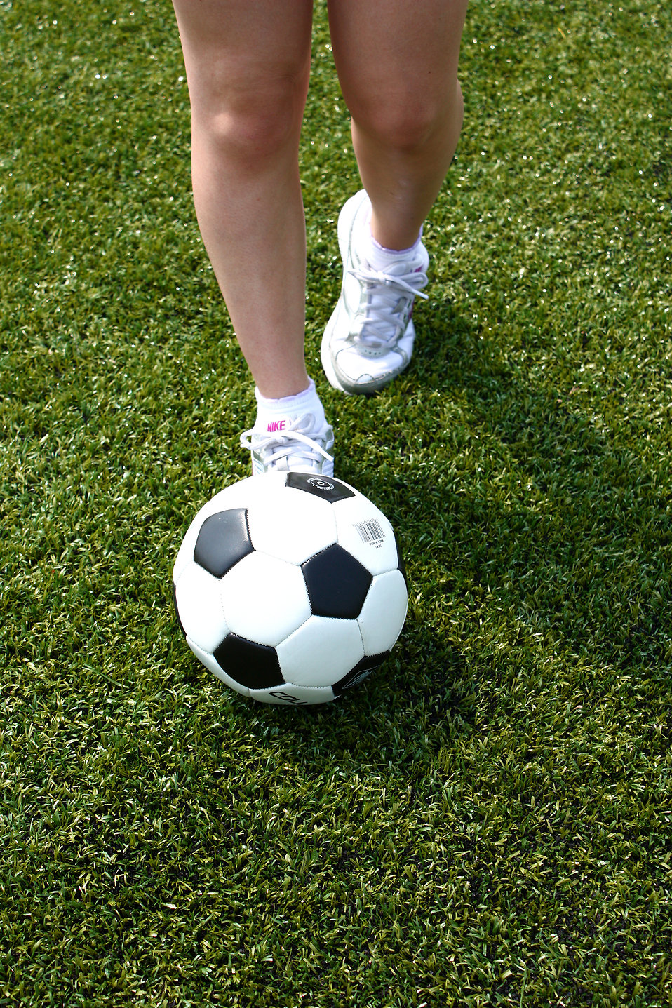 Closeup of feet and a soccer ball : Free Stock Photo