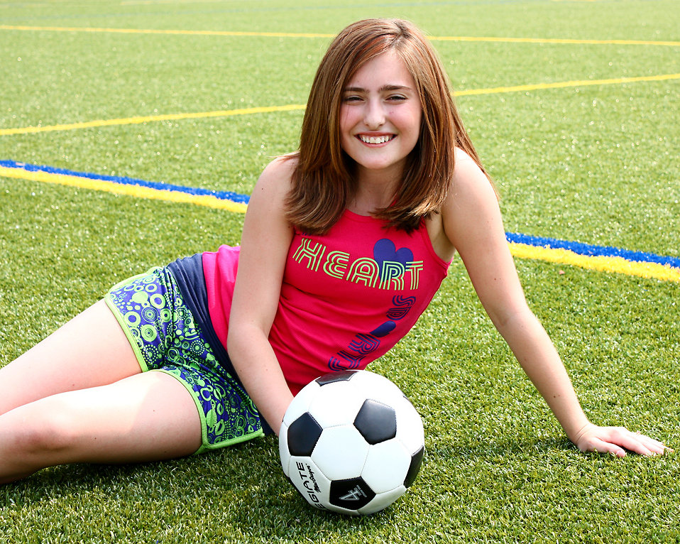 Soccer free stock photo a cute young girl posing with for Cute teenager girls