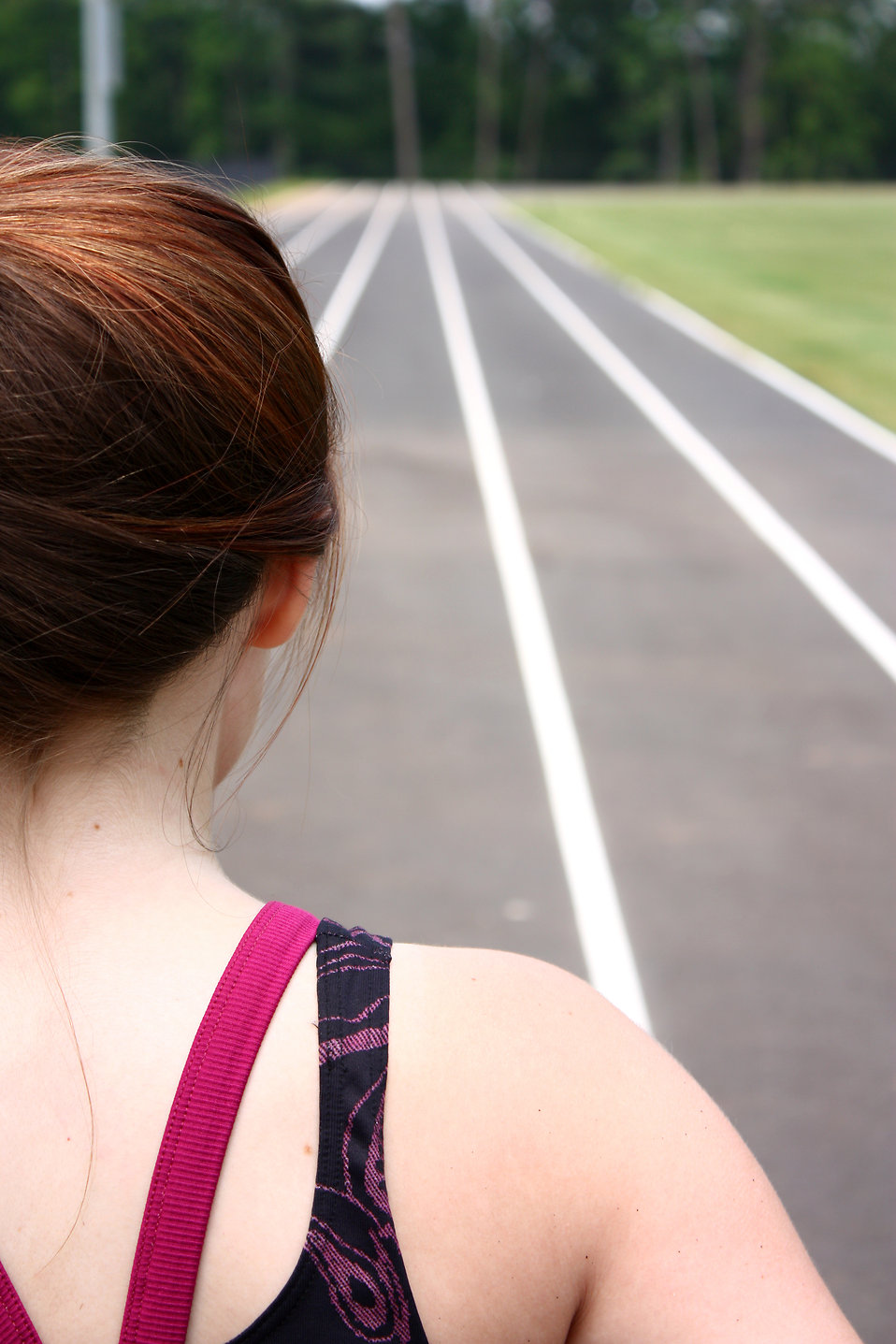 A cute young girl on a track field : Free Stock Photo