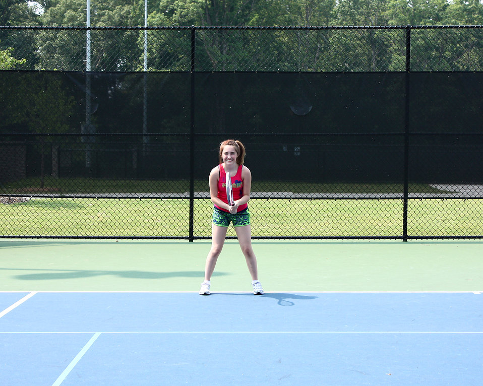 A cute young girl playing tennis : Free Stock Photo