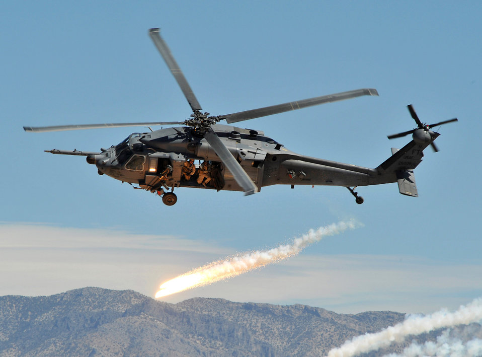 An HH-60 Pave Hawk attack helicopter firing chaff and flares : Free Stock Photo