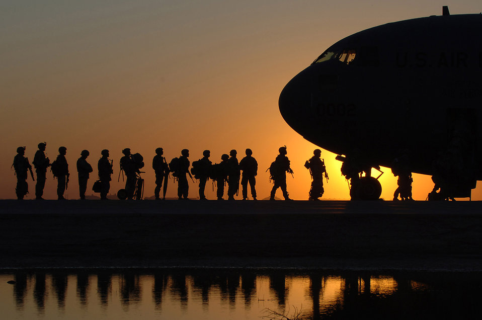 Soldiers boarding a plane at sunset : Free Stock Photo
