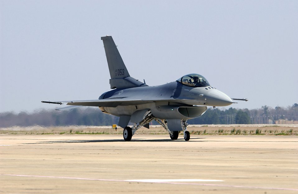 An F-16 Fighting Falcon on a runway : Free Stock Photo