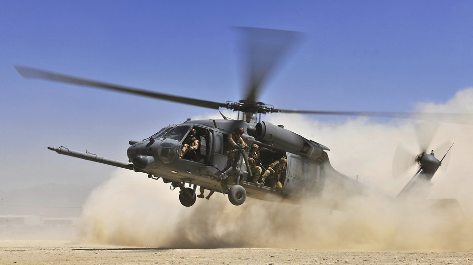 An HH-60G Pave Hawk helicopter carrying combat search and rescue Airmen approaches a landing zone during an exercise at Bagram Airfield, Afghanistan, Aug. 21. 2010. The exercise tested the rescue squadron's ability to provide medical aid to U.S. and coalition forces.