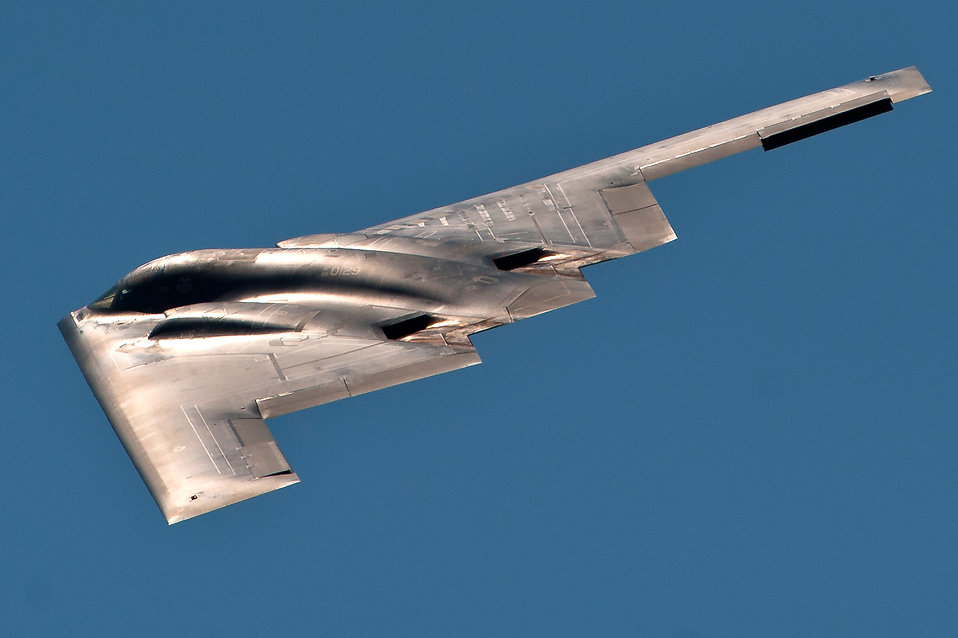 A stealth B-2 Spirit flying in the sky : Free Stock Photo
