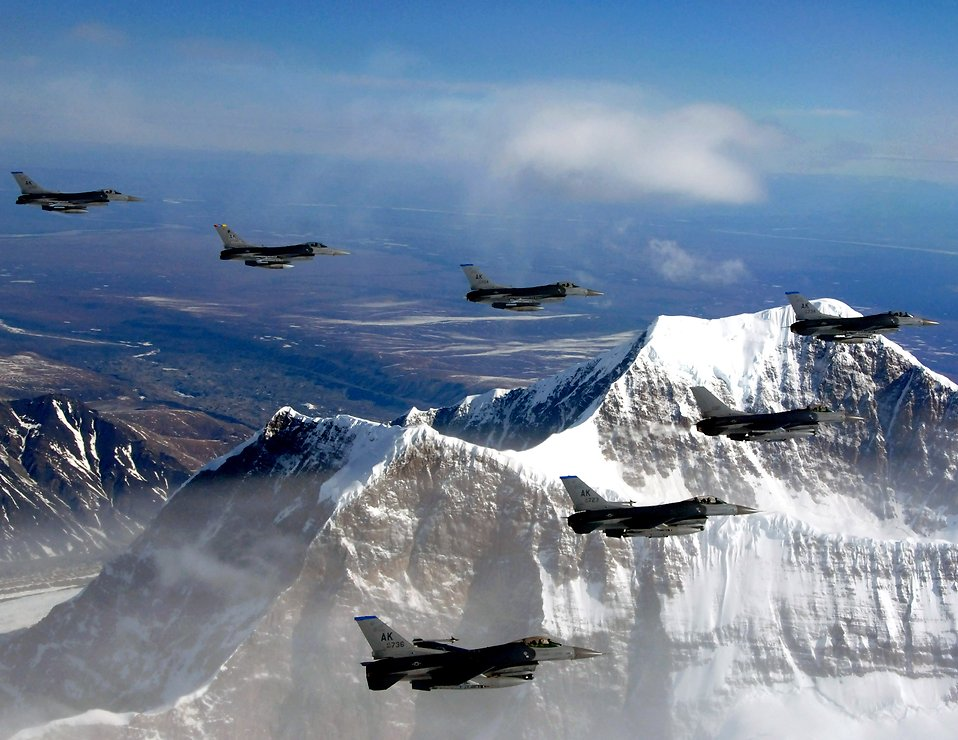Fighter jets flying in formation above mountains : Free Stock Photo