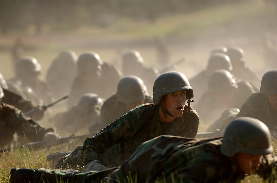 Soldiers crawling on the ground in basic training : Free Stock Photo