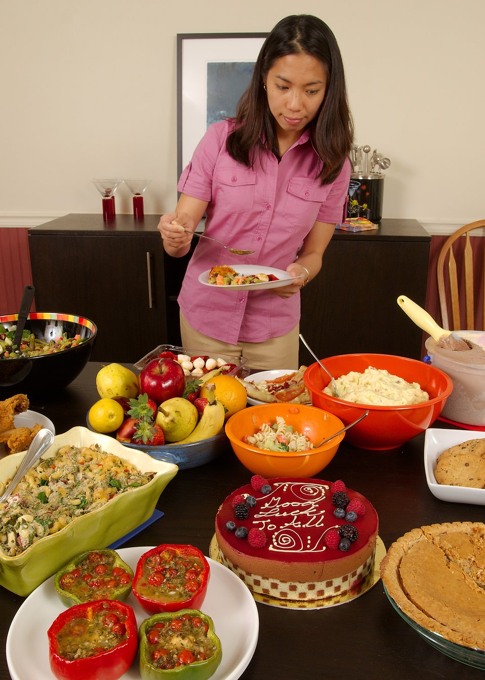 food free stock photo a young asian woman serving herself food
