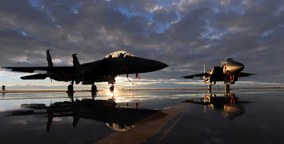 Two F-15E Strike Eagles sit on the flightline during sunset Dec. 6, 2010, at Mountain Home Air Force Base, Idaho. The aircraft are assigned to the 391st and 389th Fighter Squadrons.